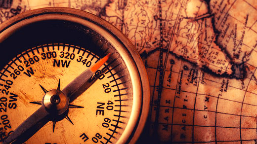 a compass on top of a map