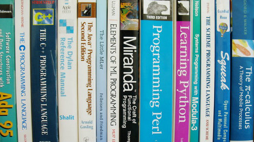 Programming books on a shelf